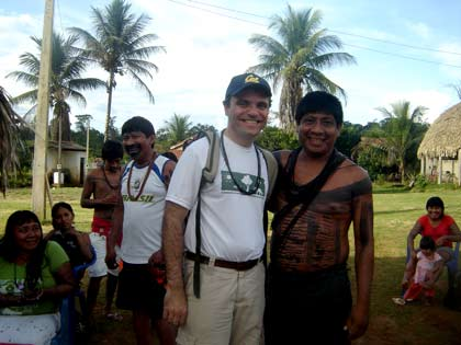 caption: Betto Borges visiting a Surui village
